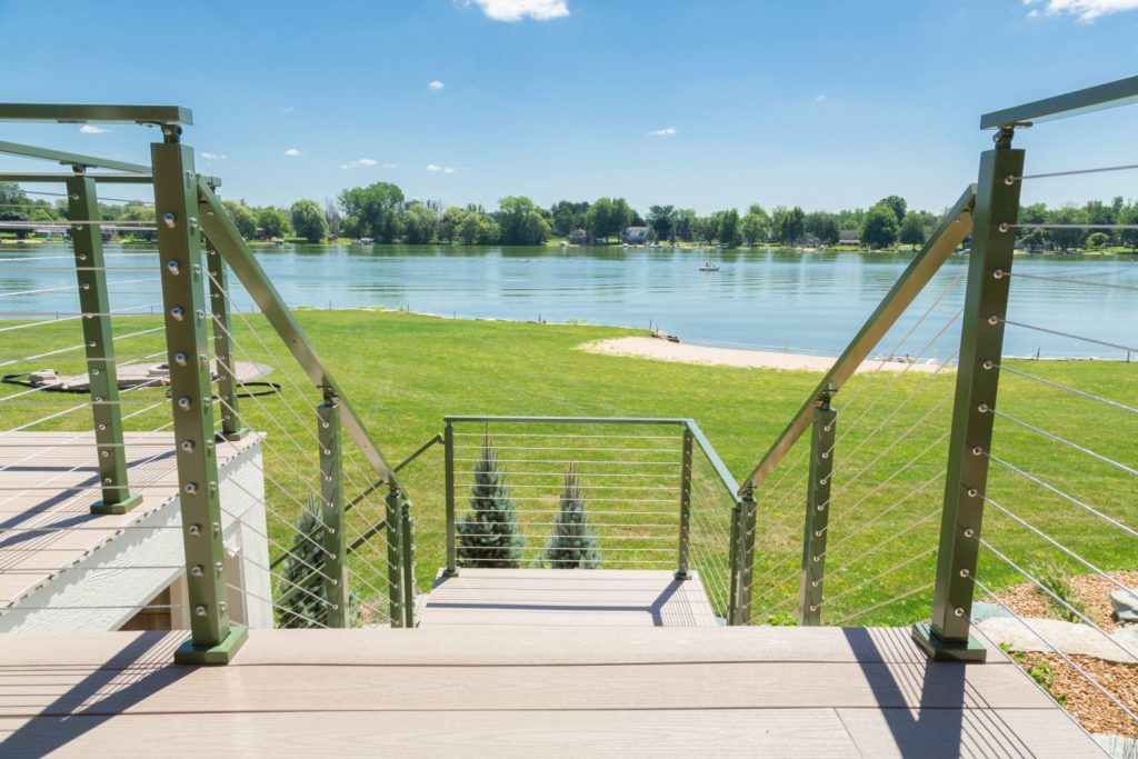 Exterior cable deck railing system with metal posts and metal railing