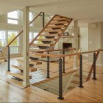 FLIGHT monostringer black posts and wood handrail
