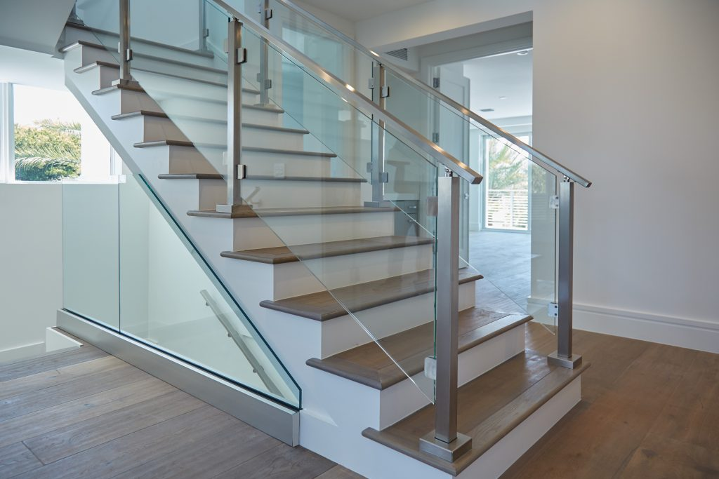 minimalistic glass system with stainless baserail handrail and posts