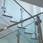 minimalistic glass system in brushed stainless from landing to 3rd story