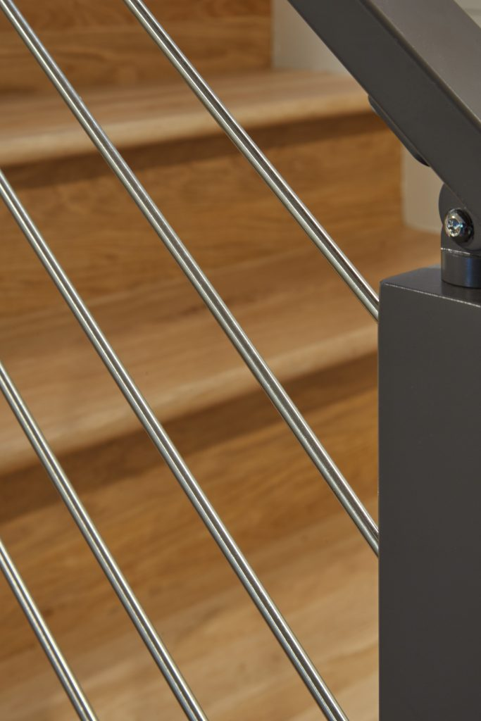 Stainless steel rod railing with aluminum posts and handrail